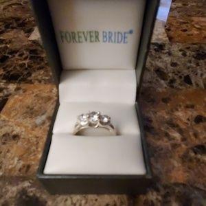 .925 stamped 3 stone zirconia ring